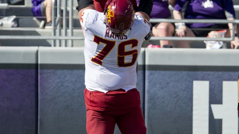 Iowa State running back Breece Hall (28) is lifted into the air by offensive lineman Joey Ramos...