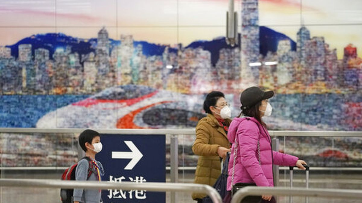 Passengers wear masks at the high speed train station, in Hong Kong, Wednesday, Jan. 22, 2020. Hong Kong's Department of Health on Wednesday confirmed its first case of the new strain of coronavirus, which has been spreading in China. (AP Photo/Kin Cheung)