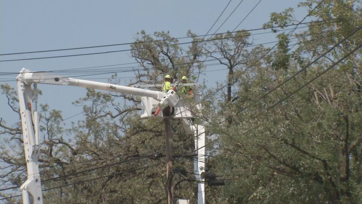 Crews worked to restore power to thousands of Iowans following Monday's derecho.