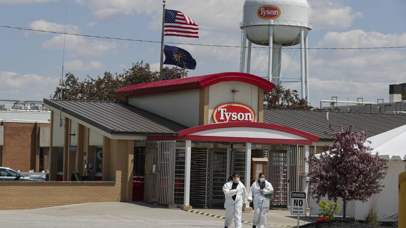 FILE - In this May 7, 2020 file photo, workers leave the Tyson Foods pork processing plant in...