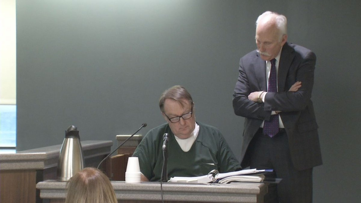 Jerry Burns, left, takes the stand in his own defense for an evidence suppression hearing on...