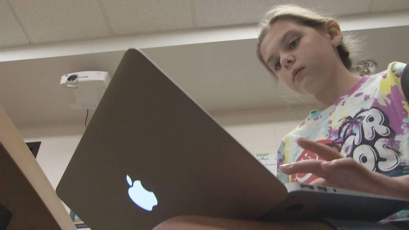 Williamsburg Junior High Student Loralie Childers works on her laptop.