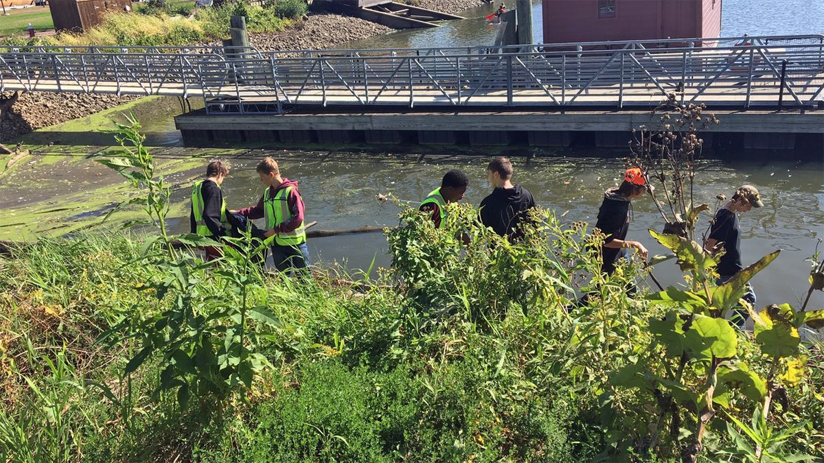 Western Dubuque High School students pick up trash at the National Mississippi River Museum and Aquarium on Wednesday, October 9, 2019. (Allison Wong/KCRG)