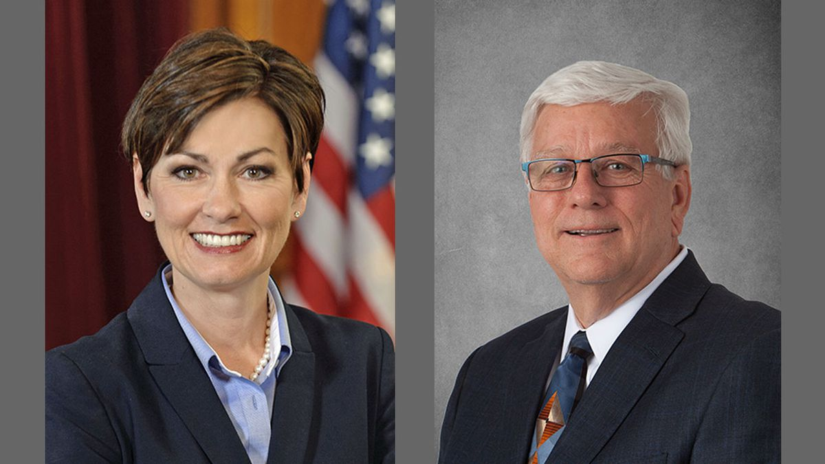 Iowa Governor Kim Reynolds, left, and Jerry Foxhoven, former Department of Human Services...