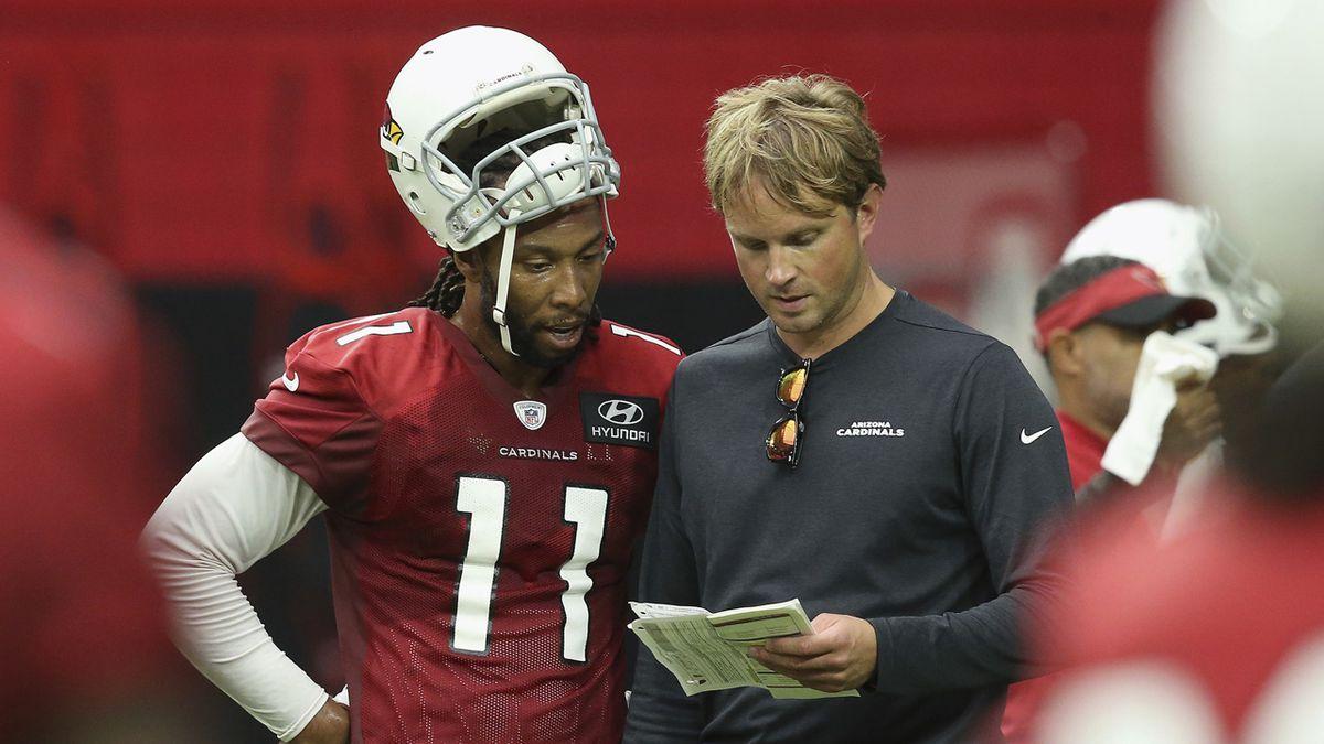 Arizona Cardinals wide receiver Larry Fitzgerald (11) talks with receivers coach David Raih,...