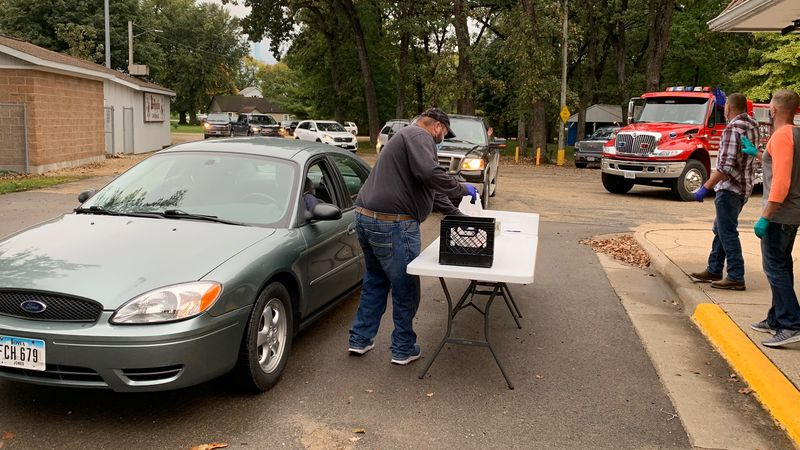 Supporters of the Worthington Community Fire Department pick up meals during a curbside steak...