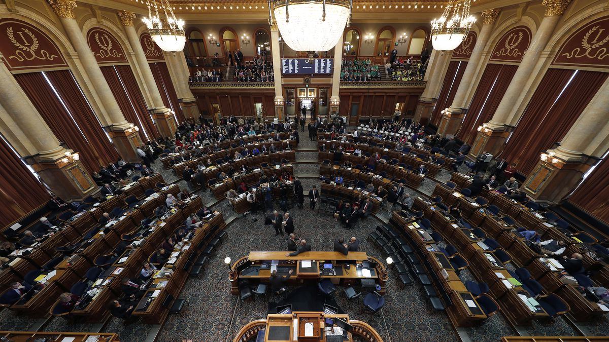Members of  a joint session of the Iowa Legislature and visitors gather for Iowa Gov. Kim Reynolds' Condition of the State address, Tuesday, Jan. 14, 2020, at the Statehouse in Des Moines, Iowa. (AP Photo/Matthew Putney)
