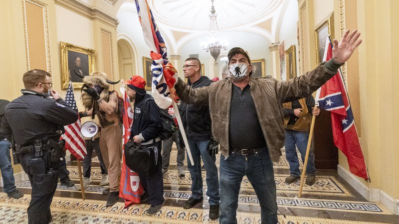 Supporters of President Donald Trump are confronted by U.S. Capitol Police officers outside the...