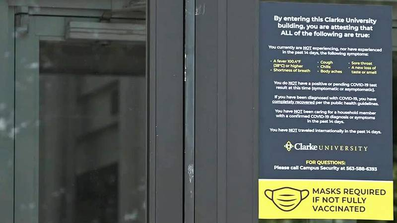 A sign at a door at Clarke University describing mask policies.