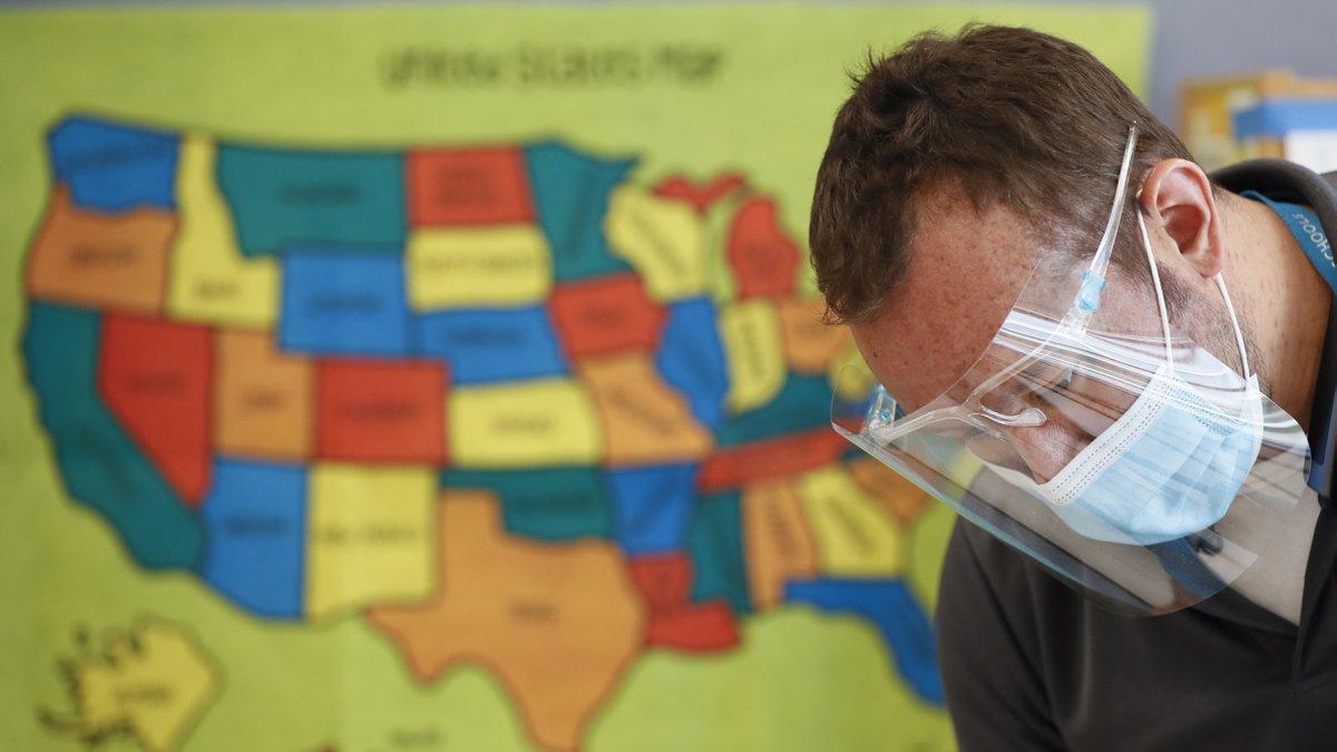 FILE - In this July 8, 2020, file photo, Des Moines Public Schools custodian Joel Cruz cleans a...