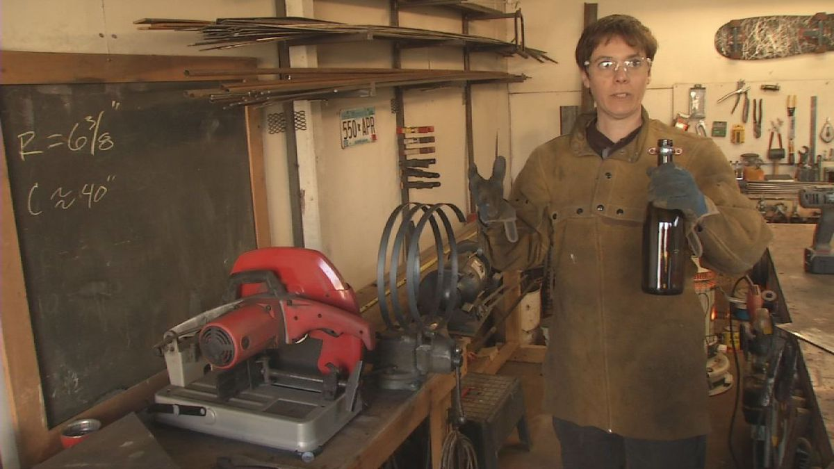 Cara Briggs Farmer, of Marion, works in her garage.  Her operation, Synergy Metalworks, strives to combine math, engineering and art into decorative pieces.