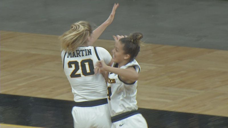 Iowa's Kate Martin and Gabbie Marshall celebrate Martin's buzzer-beater to end the first quarter.