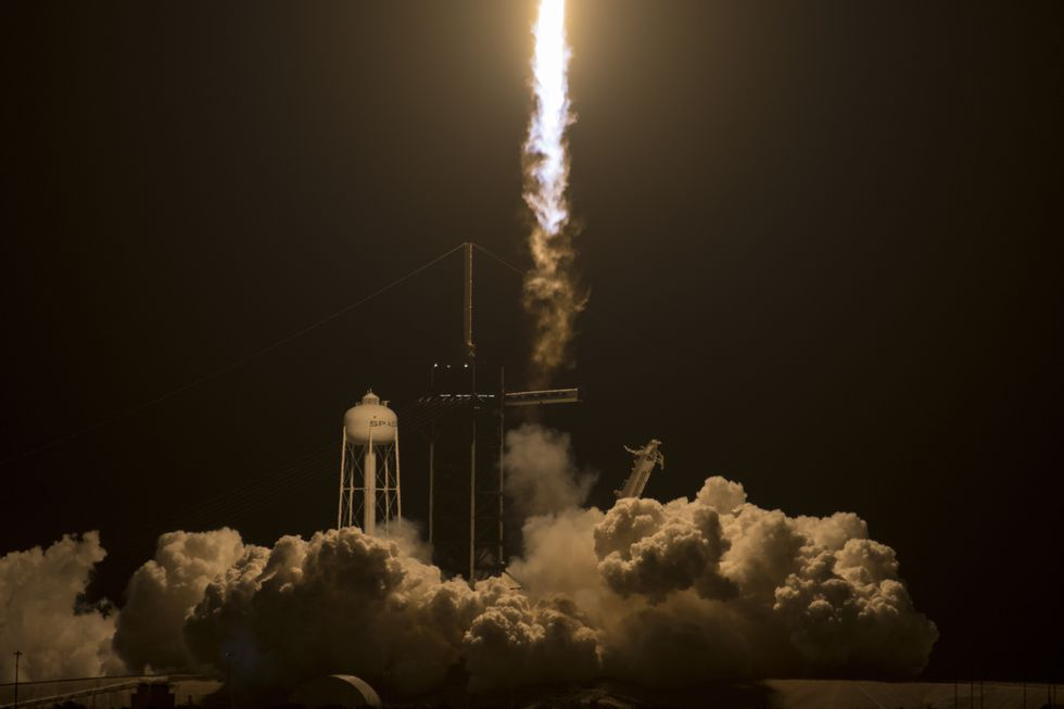A SpaceX Falcon 9 rocket carrying the company's Crew Dragon spacecraft is launched on NASA's...