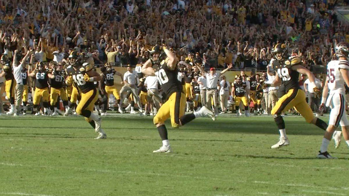 Iowa Hawkeyes Jack Hockaday, Jake Gervase, and Nick Niemann celebrate at the Outback Bowl on...