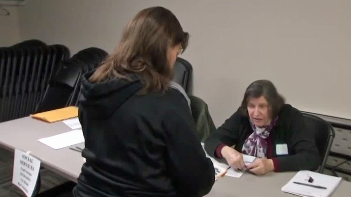 Jean Keeley, the office manager at Grace Community Church in North Liberty, participates in an ex-offender simulation, emulating what it's like for people getting out of prison to get re-acclimated to becoming law-abiding citizens with stable jobs. (Marlon Hall/KCRG)