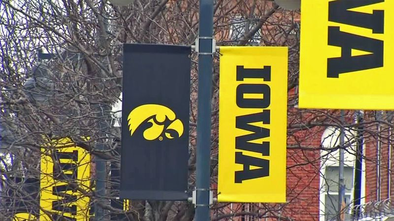 Banners for the University of Iowa hang from light posts in Iowa City.