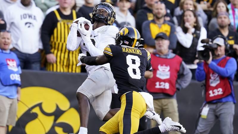 Purdue wide receiver David Bell catches a 21-yard touchdown pass over Iowa defensive back Matt...