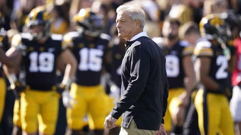 Iowa head coach Kirk Ferentz walks on the field before an NCAA college football game against...