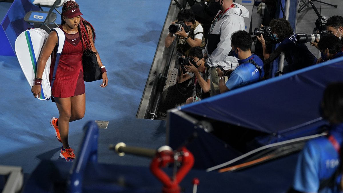 Naomi Osaka, of Japan, leaves center court after being defeated by Marketa Vondrousova, of the...