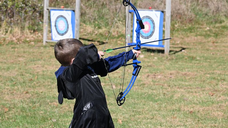 A camper aims an arrow during a fall session in October 2020 at Howard H. Cherry Scout...