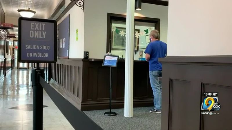 Terry Schute pays his bills at city hall in person for the first time in over a year.