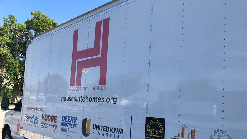 Houses into Homes truck at Central Furniture Rescue collecting donations