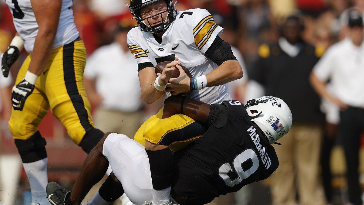 Iowa State defensive end Will McDonald (9) sacks Iowa quarterback Spencer Petras (7) during the...