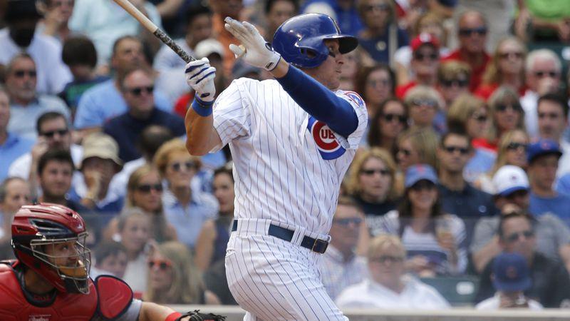 Chicago Cubs' Ryan Sweeney hits a three-run home run off St. Louis Cardinals starting pitcher...