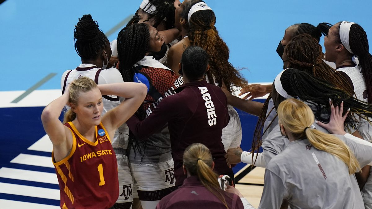 Iowa State guard Madison Wise (1) walks off the court as Texas A&M players celebrate after a...