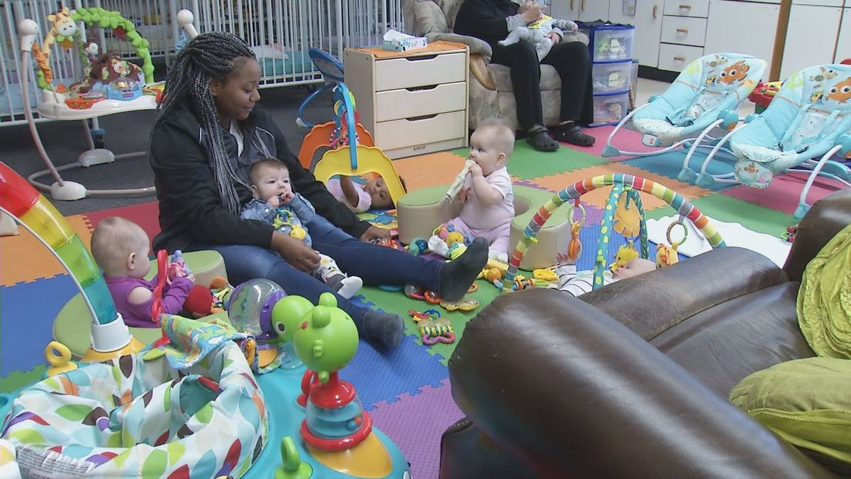 Nikea Bennett watches kids after she received a certificate through the Opportunity Dubuque program. (Charlie Grant, KCRG)