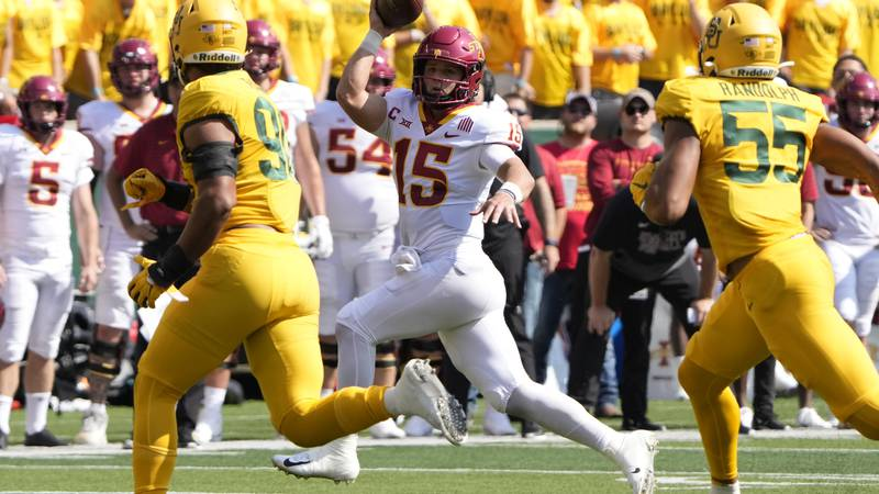 Iowa State quarterback Brock Purdy (15) runs as he looks to pass against Baylor during the...