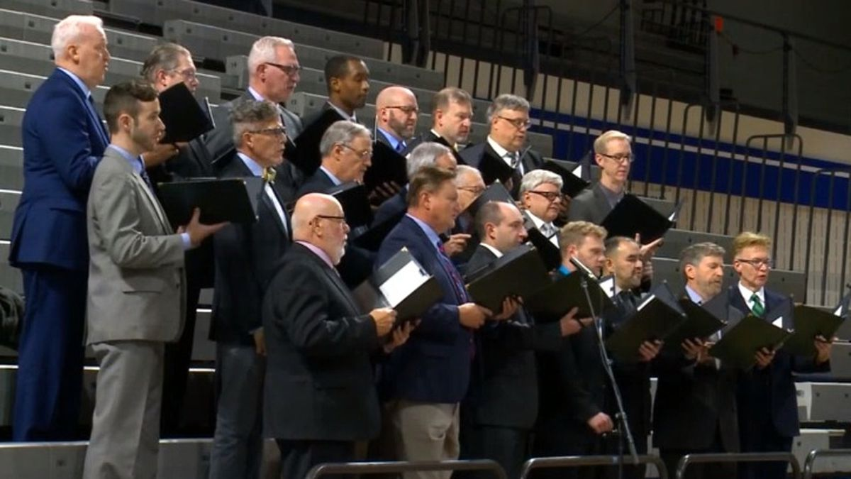 A men's choir performs at a public memorial service for the late Iowa Supreme Court Chief Justice Mark Cady on Wednesday, Nov. 20, 2019 (KCCI)