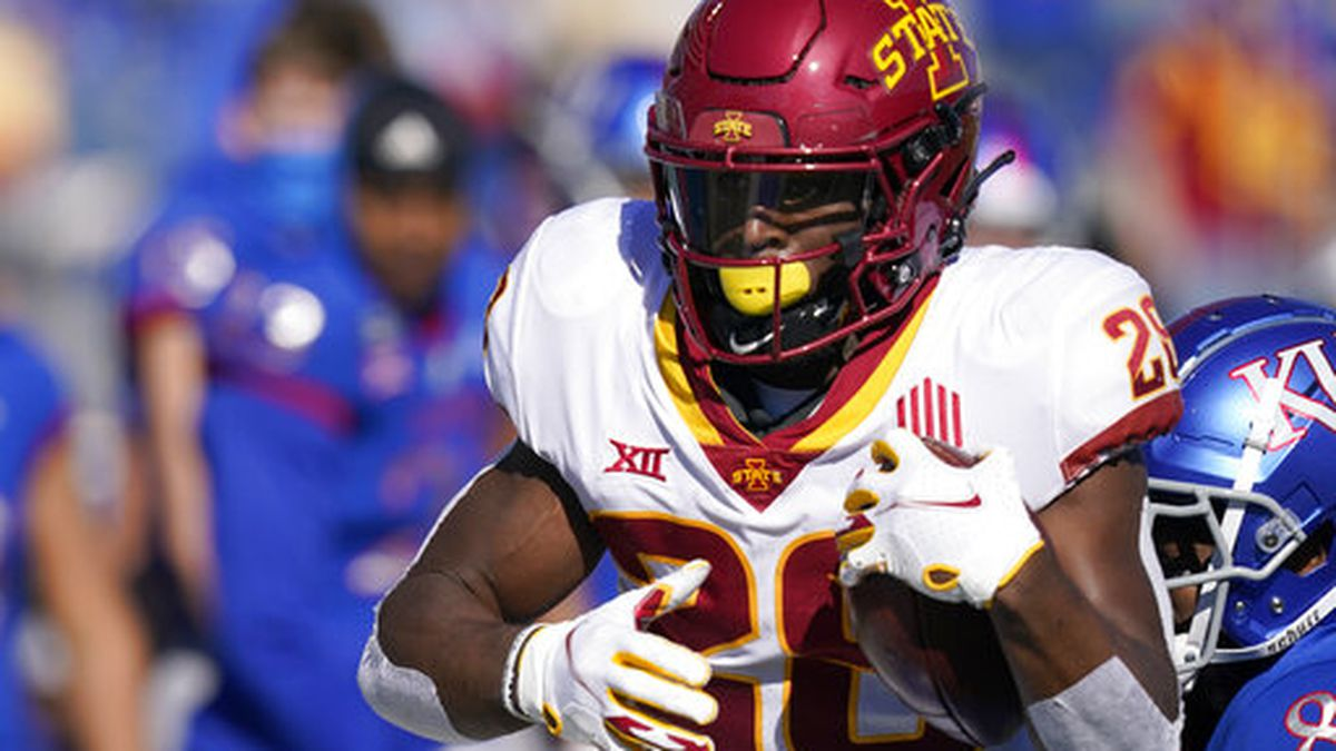 Iowa State running back Breece Hall (28) gets past Kansas cornerback Kyle Mayberry (8) during...