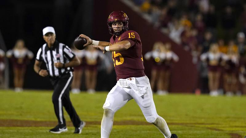 Iowa State quarterback Brock Purdy (15) throws a pass during the second half of an NCAA college...