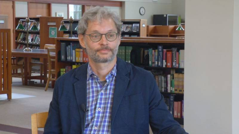 Professor Todd Knoop, of Cornell College, projects how he thinks the finances and economics of...