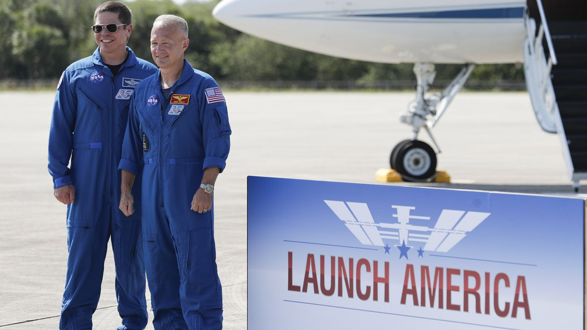 NASA astronauts Robert Behnken, left, and Doug Hurley pose for a photo at a news conference after they arrived at the Kennedy Space Center in Cape Canaveral, Fla., Wednesday, May 20, 2020. The two astronauts will fly on the SpaceX Demo-2 mission to the International Space Station scheduled for launch on May 27. (AP Photo/John Raoux)