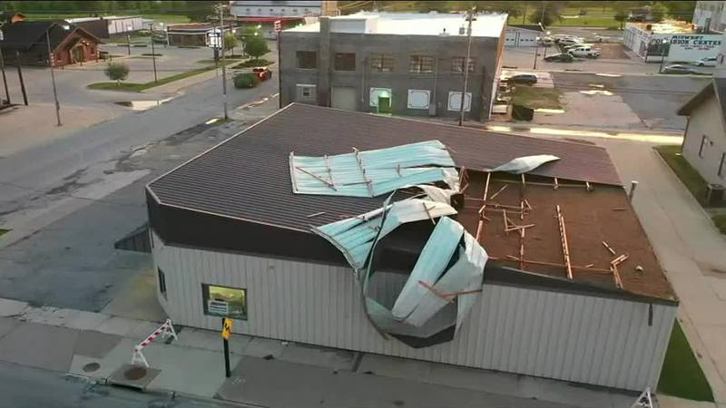 The roof of Baron Auto Supply in Oelwein stands peeled away by strong thunderstorm winds on...