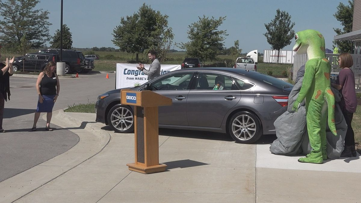 The Domestic Violence Intervention Program received a donated car from GEICO, Toyota of Iowa City, and Alba Auto Repair and Glass at the GEICO offices in North Liberty on Thursday, August 22, 2019. (Aaron Scheinblum/KCRG)