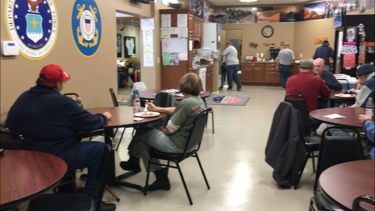 Veterans and volunteers eat lunch at the Veterans Freedom Center in Dubuque on Friday, Nov. 9. (Allison Wong, KCRG-TV9)