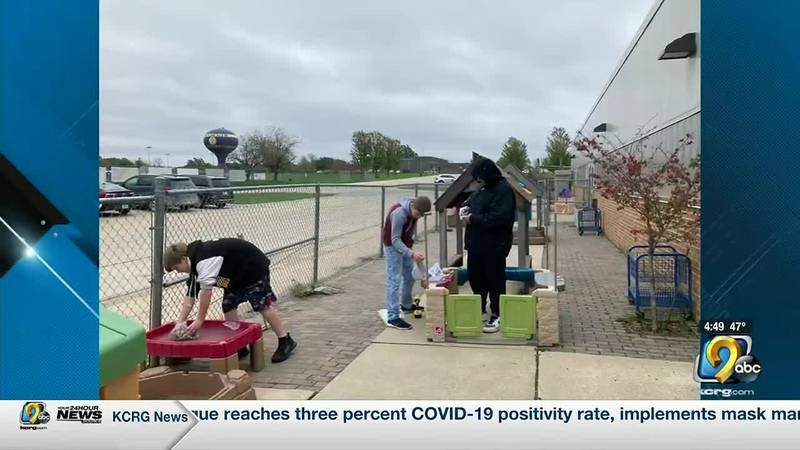 Students are helping to fix a playground after a tornado damaged part of the Oelwein Communtiy...
