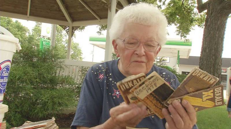 Jean Stinocher, 87, of Solon, shows off the seed corn notepads her late husband, Bob, kept for...