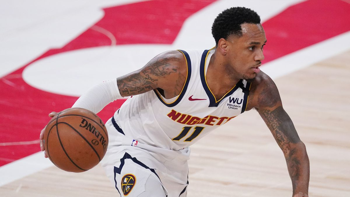 Denver Nuggets' Monte Morris (11) plays against the Los Angeles Lakers during the first half of...