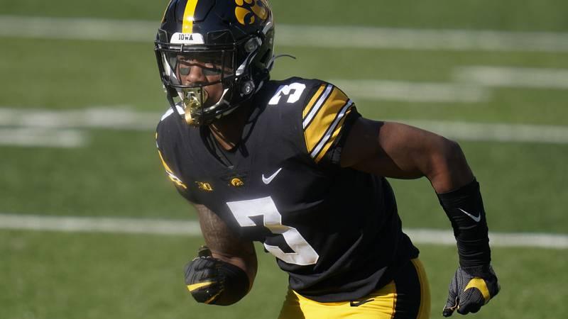 FILE - In this Saturday, Nov. 7, 2020 file photo, Iowa wide receiver Tyrone Tracy Jr. runs on...