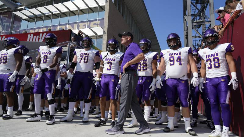Northern Iowa head coach Mark Farley waits for his team to enter the field for an NCAA college...