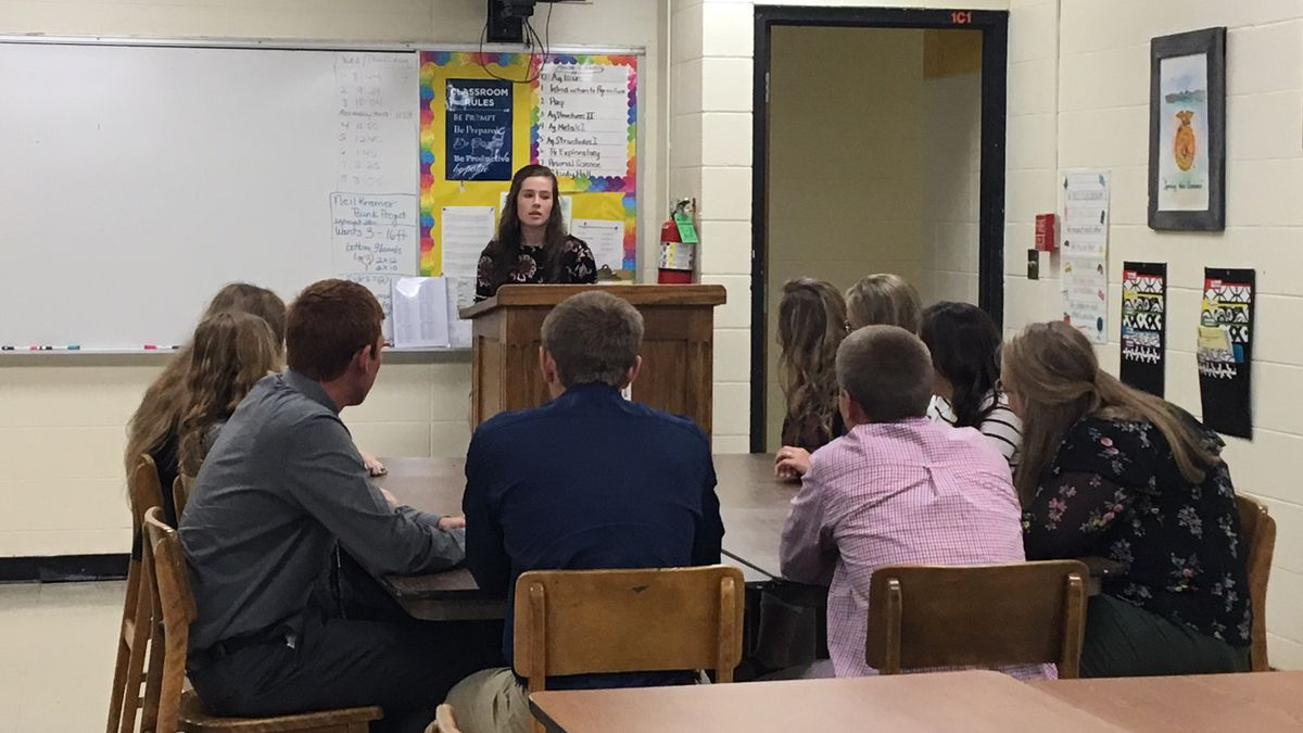 Shelby Westhoff leads the FFA meeting at Beckman Catholic High School on Thursday, Sept. 20,...