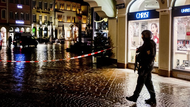 Police officers guard the scene of an incident in Trier, Germany, Tuesday, Dec. 1, 2020.