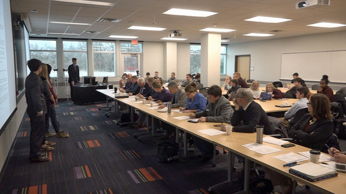 Students present to a group of area business and community leaders at the University of Iowa...