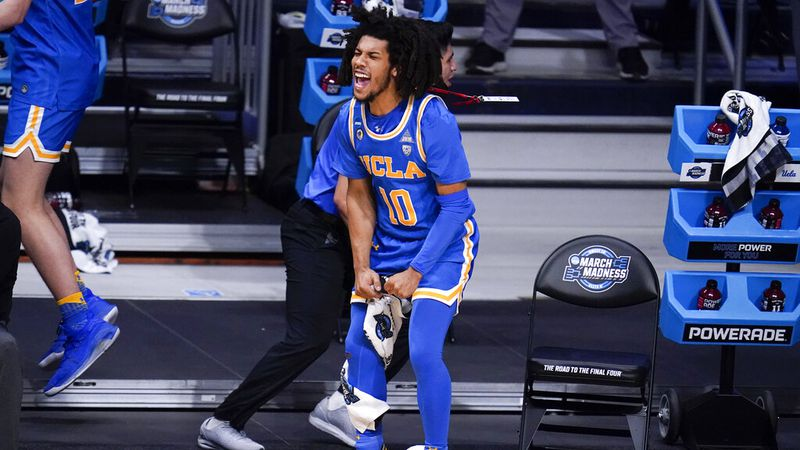 UCLA guard Tyger Campbell (10) reacts to a play against Alabama in the first half of a Sweet 16...
