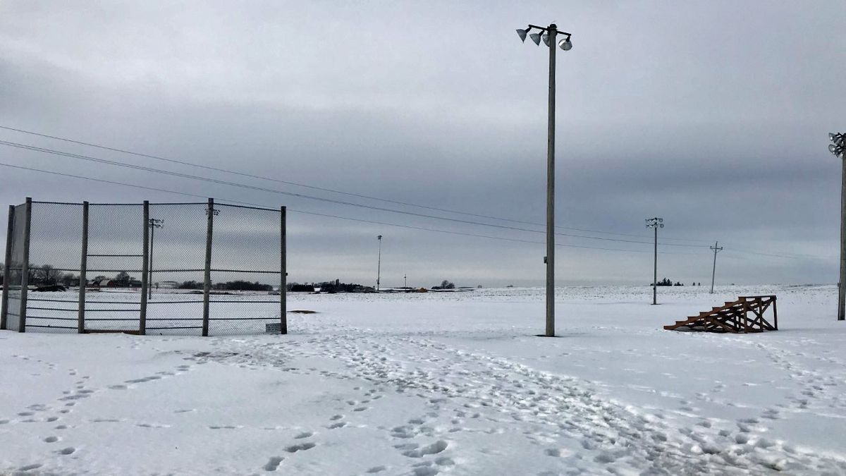 New light towers are visible in the distance at the Field of Dreams near Dyersville on Feb. 4,...