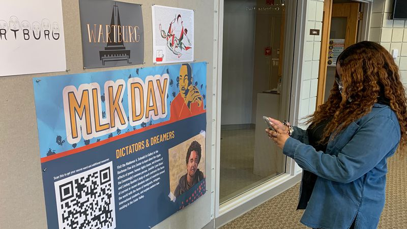 Wartburg student Carrington Bush scans a QR code on a poster on campus on Jan. 18, 2021.